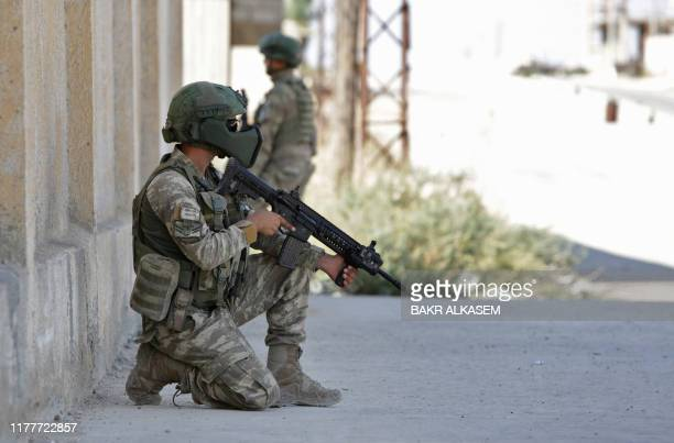 Turkish soldiers patrol the northern Syrian Kurdish town of Tal Abyad on October 23 2019 Moscow's forces in Syria headed for the border with Turkey...