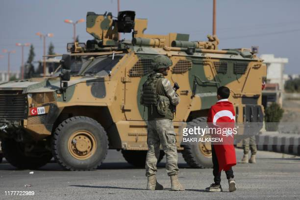 TOPSHOT Turkish soldiers patrol the northern Syrian Kurdish town of Tal Abyad on the border between Syria and Turkey on October 23 2019 Moscow's...