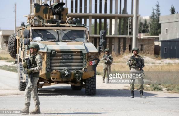 Turkish soldiers patrol the northern Syrian Kurdish town of Tal Abyad on the border between Syria and Turkey on October 23 2019 Moscow's forces in...