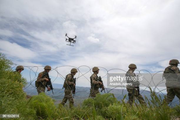 Turkish soldiers patrol the with a drone at northern Iraq's AvashinBasyan region on May 21 2018 Turkish military officers on duty at Sera Batin Hill...