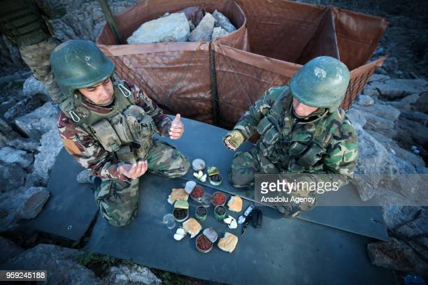 Turkish soldiers pray before breaking their fast on the first day of Holy month of Ramadan at the highaltitude base in Mount Balkaya in Semdinli...