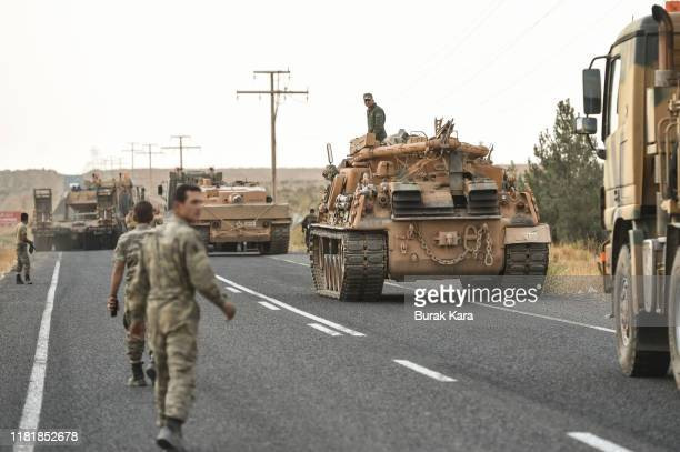 Turkish soldiers preparer the tanks as they secures the road before army tanks start moving towards the Syrian border on October 18 2019 in...
