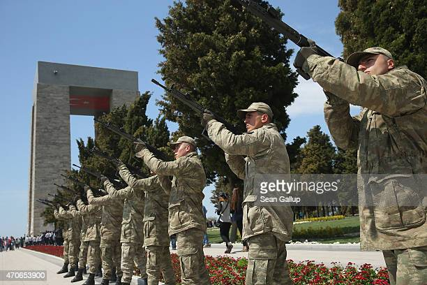 Turkish soldiers raise their rfiles as they rehearse a ceremony at the Canakkale Martyrs' Memorial which is the biggest memorial to Turkish soldiers...