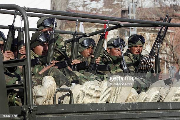 Turkish soldiers return from their mission in trucks near the southeastern Turkish border town of Cukurca bordering Iraq on February 29 2008 Turkey...