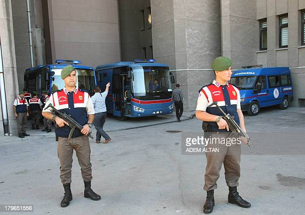 Turkish soldiers secure the area as vehicles carrying detained Turkish army officers arrive at a courthouse in Ankara September 6 prior to a hearing...