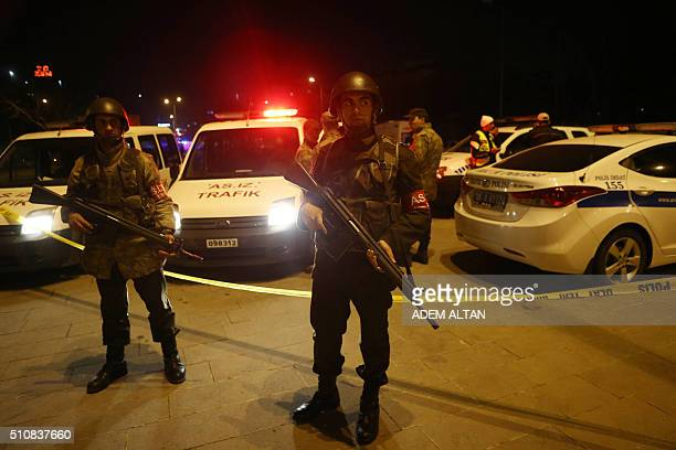 Turkish soldiers secure the site of an explosion after an attack targeted a convoy of military service vehicles in Ankara on February 17 2016 At...