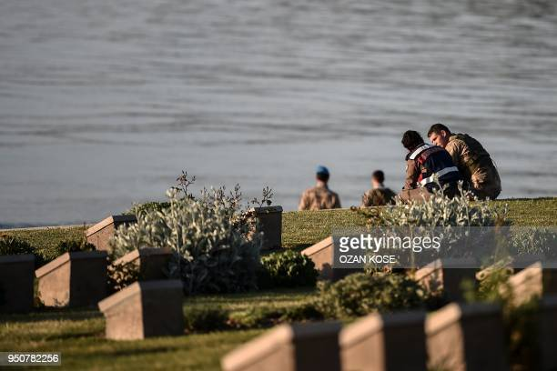 Turkish soldiers sit and speak on the Anzac cove in Canakkale on April 24 before a ceremony marking the 103rd anniversary of ANZAC Day The April 25...