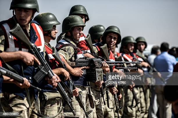 Turkish soldiers stand guar near the TurkeySyrian border post in Sanliurfa on September 4 as they wait for the arrival of the hearse carrying the...