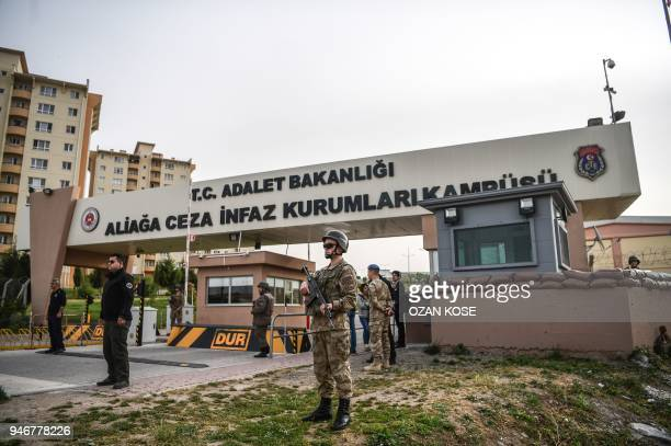 Turkish soldiers stand guard at the entrance of the Aliaga court and prison complex during the trial of US pastor Andrew Brunson held on charges of...