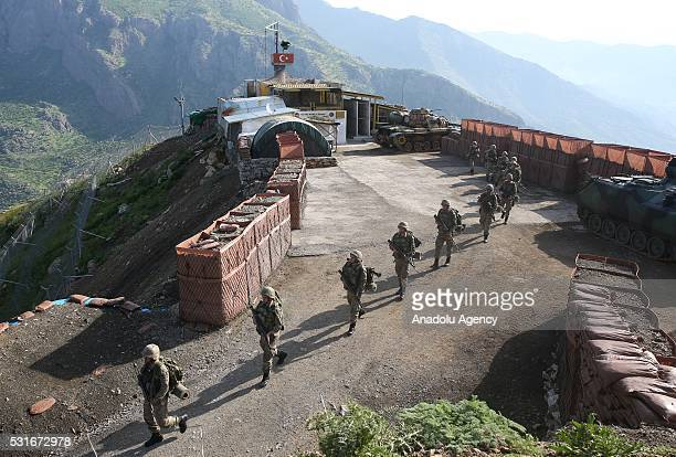 Turkish soldiers stand guard at the Modular Temporary Base Area also known as Hawk Eye at the 34th Border Brigade's Red Hill military post in...