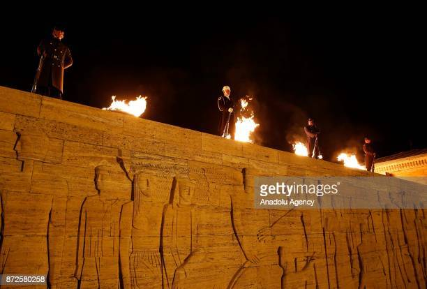Turkish soldiers stand guard next to firebrands as people visit Anitkabir mausoleum of Mustafa Kemal Ataturk founder of the Republic of Turkey during...