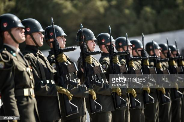 Turkish soldiers stand guard on April 24 2018 in Canakkale during an international service marking the 103rd anniversary of the World War I campaign...
