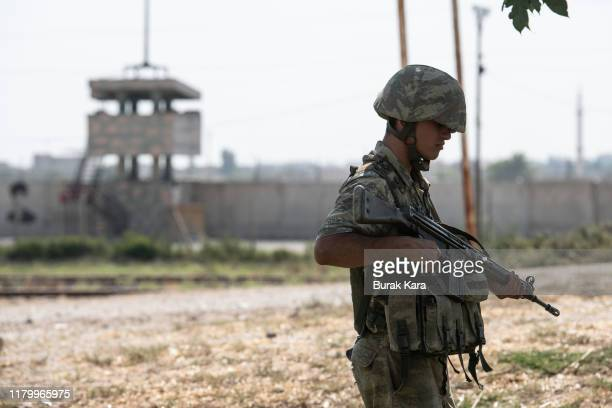 Turkish soldiers stand guard on the Turkish side of the border between Turkey and Syria on October 09 2019 in Akcakale Turkey Military personnel and...