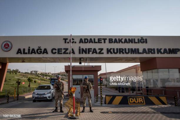 Turkish soldiers stand guard outside the entrance to Aliaga Prison Court after American pastor Andrew Brunson arrived ahead of his court hearing on...