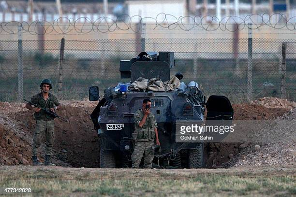 Turkish soldiers stand guarded near the Akcakale border gate in Sanliurfa province Turkey June 16 2015 Kurdish fighters took full control on Tuesday...