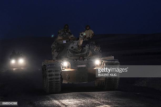TOPSHOT Turkish soldiers stand in a Turkish army tank driving back to Turkey from the SyrianTurkish border town of Jarabulus on September 1 2016 in...