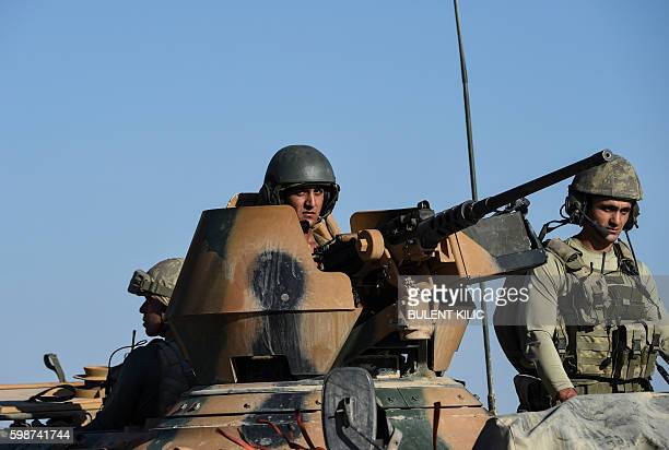 TOPSHOT Turkish soldiers stand in a Turkish army tank driving back to Turkey from the SyrianTurkish border town of Jarabulus on September 2 2016 in...