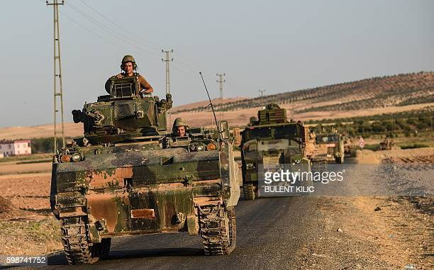 Turkish soldiers stand in a Turkish army tank driving back to Turkey from the SyrianTurkish border town of Jarabulus on September 2 2016 in the...