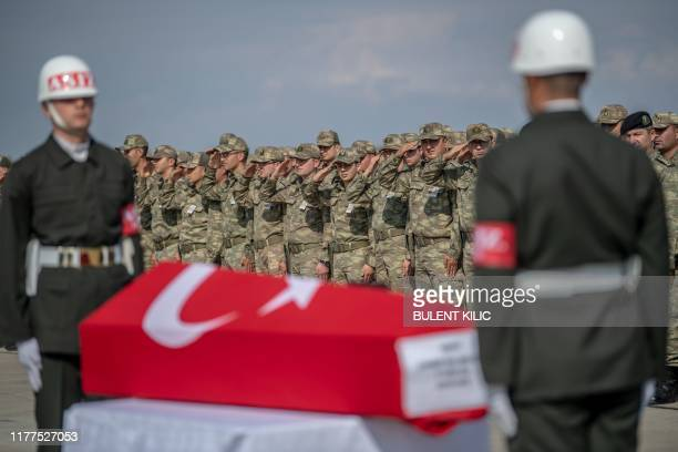 TOPSHOT Turkish soldiers stand in front of the coffin of a soldier who was killed during Turkey's military operation against Kurdish forces in Syria...