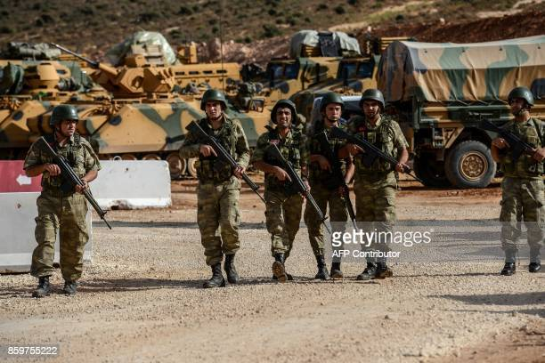 Turkish soldiers stand near armoured vehicles during a demonstration in support of the Turkish army's Idlib operation near the TurkeySyria border...