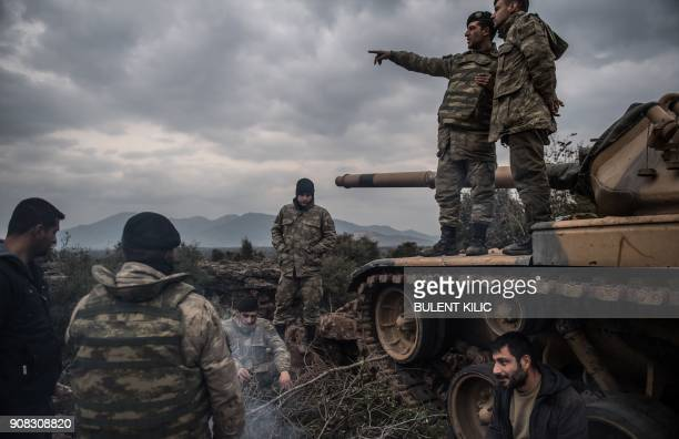 TOPSHOT Turkish soldiers wait near the Syrian border at Hassa in Hatay province on January 21 2018 Turkish forces on January 20 began a major new...