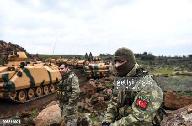 Turkish soldiers wait near the Syrian border at Hassa in Hatay province on January 21 2018 Turkish forces on January 20 began a major new operation...