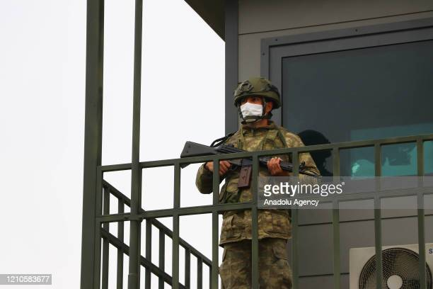 Turkish soldiers wears a mask as he is on guard duty within precautions against coronavirus pandemic at 66th Mechanised Infantry Brigade Command in...