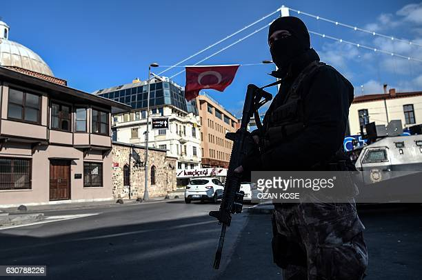 A Turkish special force police officer stands guard at ortakoy district near the Reina night club on January 2 2017 in Istanbul one day after New...