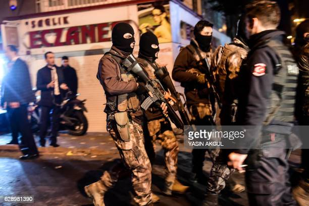 TOPSHOT Turkish special force police officers patrol streets after a car bomb exploded near the stadium of football club Besiktas in Istanbul on...
