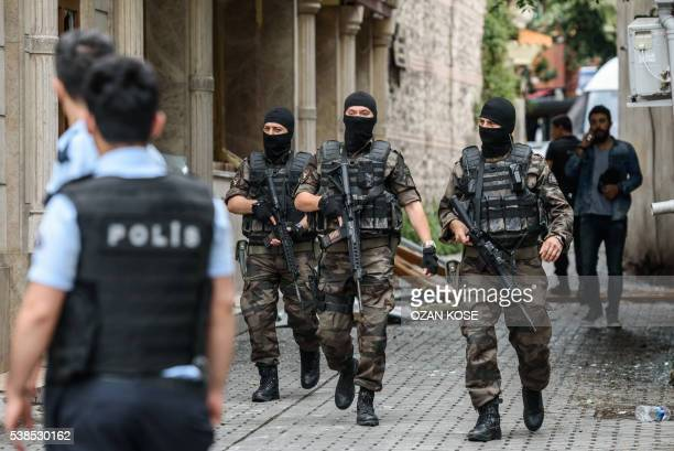 Turkish special force Police officers secure area around the site of a bomb attack that targeted a police bus in the Vezneciler district of Istanbul...