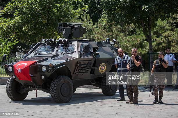 Turkish special forces personel guard the entrance to the Ankara Courthouse where a hearing for generals and military personel involved in Friday's...