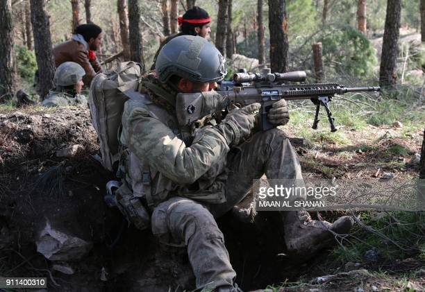 A Turkish special forces soldier takes aim on a mountain on the SyrianTurkish border north of Azaz on January 28 2018 Turkey launched operation Olive...