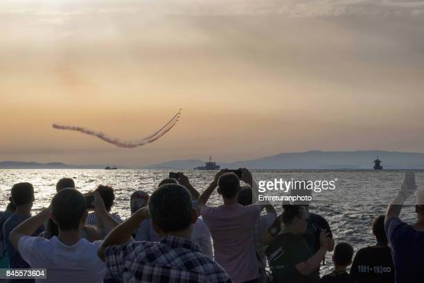 turkish stars flying in close formation over izmir bay with crowds watching - emreturanphoto stock pictures, royalty-free photos & images
