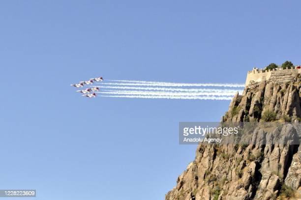 Turkish Stars, the aerobatic demonstration team of the Turkish Air Force perform during a ceremony marking the 98th anniversary of the Great...