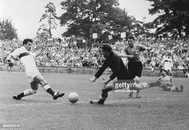 Turkish striker Ertan Mustafa beats German goalkeeper Toni Turek who is running towards him German defender Karl Mai and teammate Fritz Laband lying...