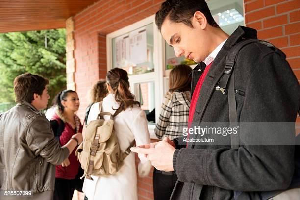 Turkish Student Using Smart Phone while Waiting Food, Break, Istanbul