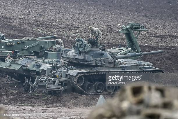 Turkish tanks are parked near the Syrian border at Hassa in Hatay province on January 24 as part of the operation 'Olive Branch' launched a few days...