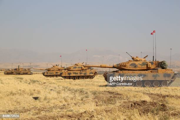 Turkish tanks are seen near the Habur crossing gate between Turkey and Iraq during a military drill on September 18 2017 Turkey launched a military...
