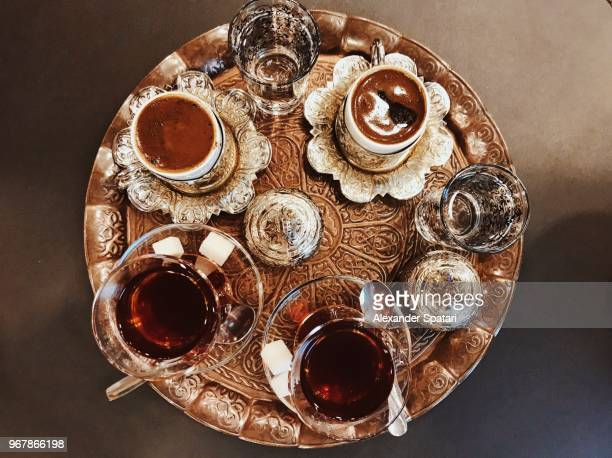 Turkish tea and Turkish coffee served in traditional bronze tray