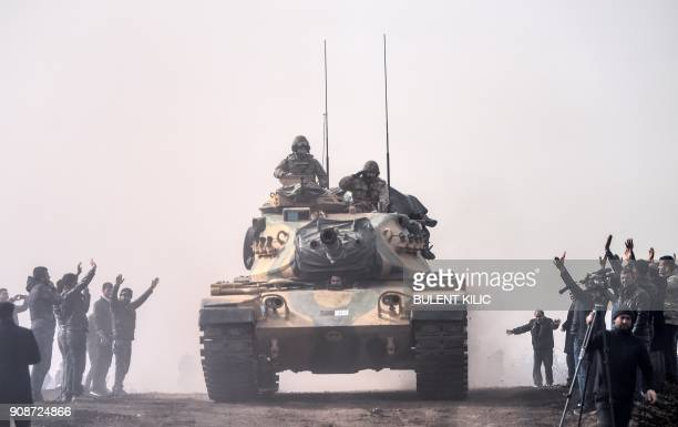 Turkish troops advance near the Syria border at Hassa Hatay province on January 22 2018 Turkey on January 22 2018 shelled Kurdish militia targets in...