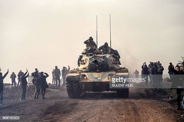 Turkish troops advance near the Syria border at Hassa Hatay province on January 22 2018 Turkey on January 22 2018 shelled Kurdish militia targets in...