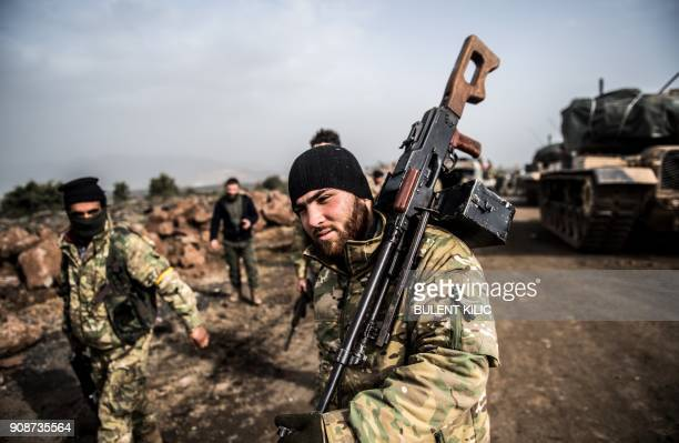 TOPSHOT Turkish troops advance near the Syria border at Hassa Hatay province on January 22 as part of the operation Olive Branch launched two days...
