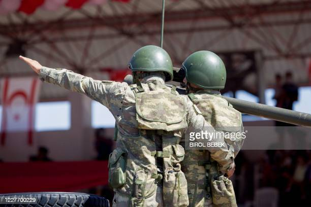 Turkish troops parade atop armoured vehicles in the northern part of Nicosia, the capital of the self-proclaimed Turkish Republic of Northern Cyprus...