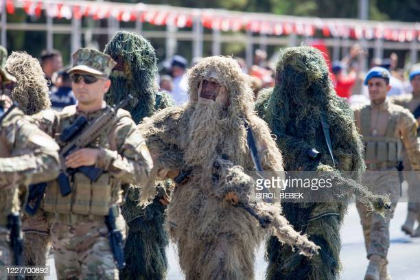 Turkish troops parade in the northern part of Nicosia, the capital of the self-proclaimed Turkish Republic of Northern Cyprus on July 20 to mark the...