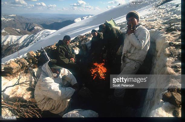 Turkish troops sit near a fire April 16 1996 near the Iraq/Turkey border Efforts by the Kurds to achieve autonomy or independence for the region have...