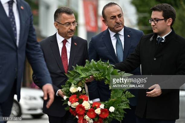 Turkish Vice President Fuat Oktay and Turkish Foreign Minister Mevlut Cavusoglu prepare to lay a wreath at the Bridge of Remembrance as a tribute to...