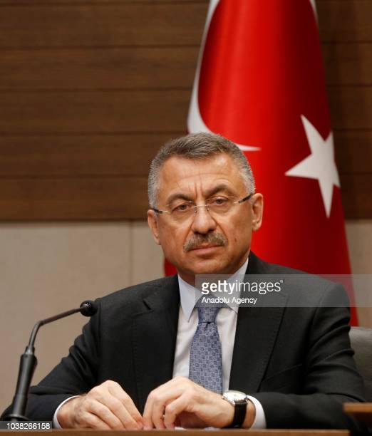 Turkish Vice President Fuat Oktay is seen as Turkish President Recep Tayyip Erdogan holds a press conference at Ataturk International Airport before...