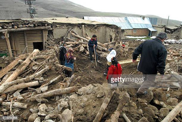 Turkish villagers search for bodies among the ruins in Okcular in the Elazig province on March 8 2010 At A powerful earthquake in eastern Turkey...