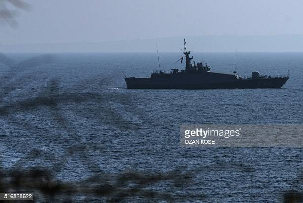 A Turkish warship patrols on the egean sea between Turkish coast and Lesbos island on March 21 2016 at Kucukkuyu district in Canakkale western Turkey...