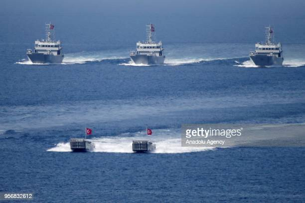 Turkish warships and assault boats approach through the Aegean Sea the coastline during the Efes-2018 Combined Joint Live Fire Exercise at...